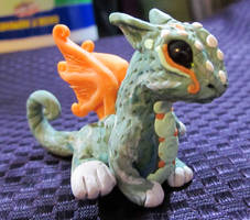 little green and orange dragon by carmendee