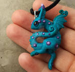 Little dancing  dragon polymer clay pendant