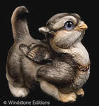 Crouching Griffin chick wolf