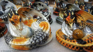 Coiled Female Dragons With Mineral Globes
