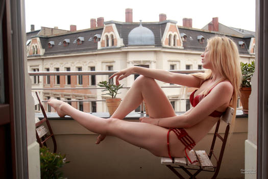 Cute blonde in lingerie on the balcony 08