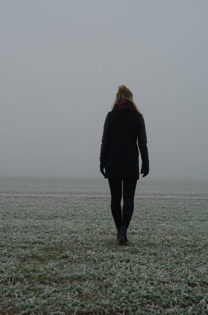 Woman in the fog STOCK