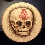 Baby skull on wood