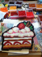 Kirby's strawberry cake in perler by mininete