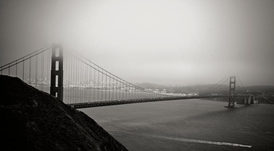 foggy bridge by TheArtOfaMadMan