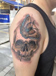 Skull with butterfly by Roger Axelsson