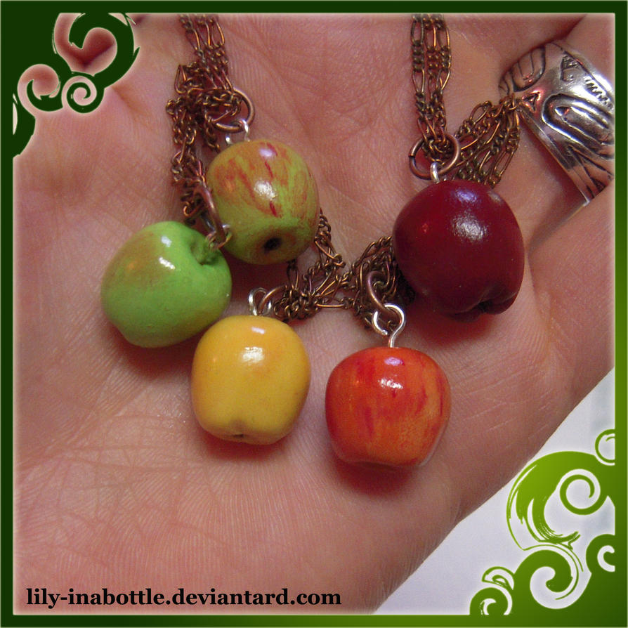 close up of apple necklace by lily-inabottle