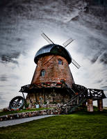 Windmill awaiting storm by BenKodjak