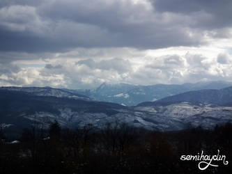 snowy hills by semihaydin