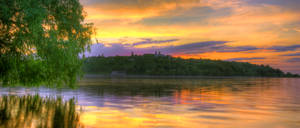 Sunset over the river by val-shevchenko