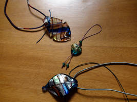 Two Necklaces And A Charm by xcmer