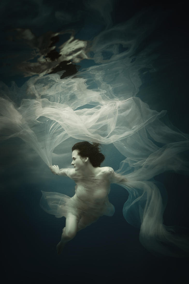 Girl in a white dress under the water by fly10