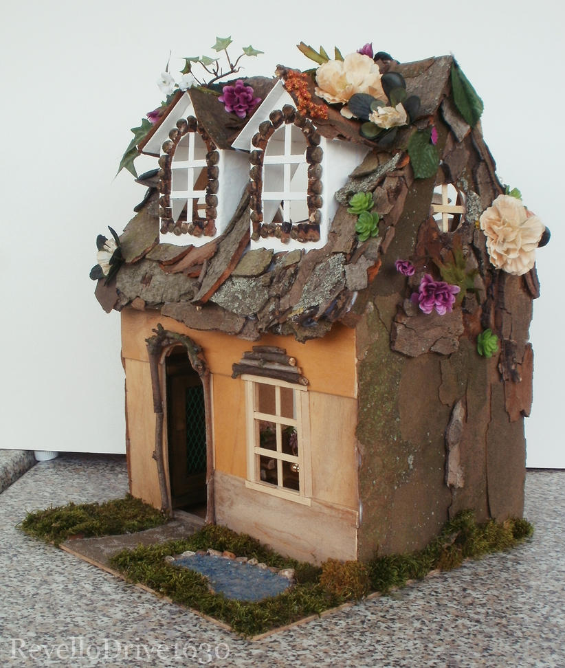 Fairy Dollhouse with flowers - outside front by RevelloDrive1630