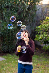 Girl and bubbles by drarock