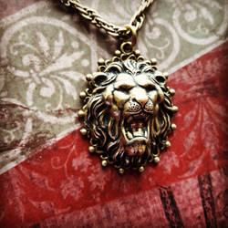 Brass roaring lion pendant