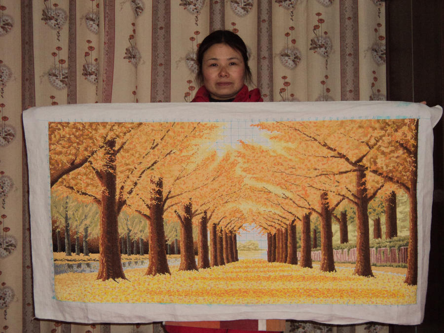 mum and her great cross-stitch by luwe2009