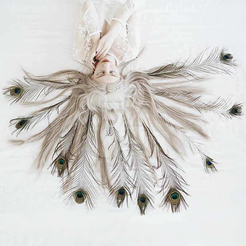 Peacock girl by thefirebomb