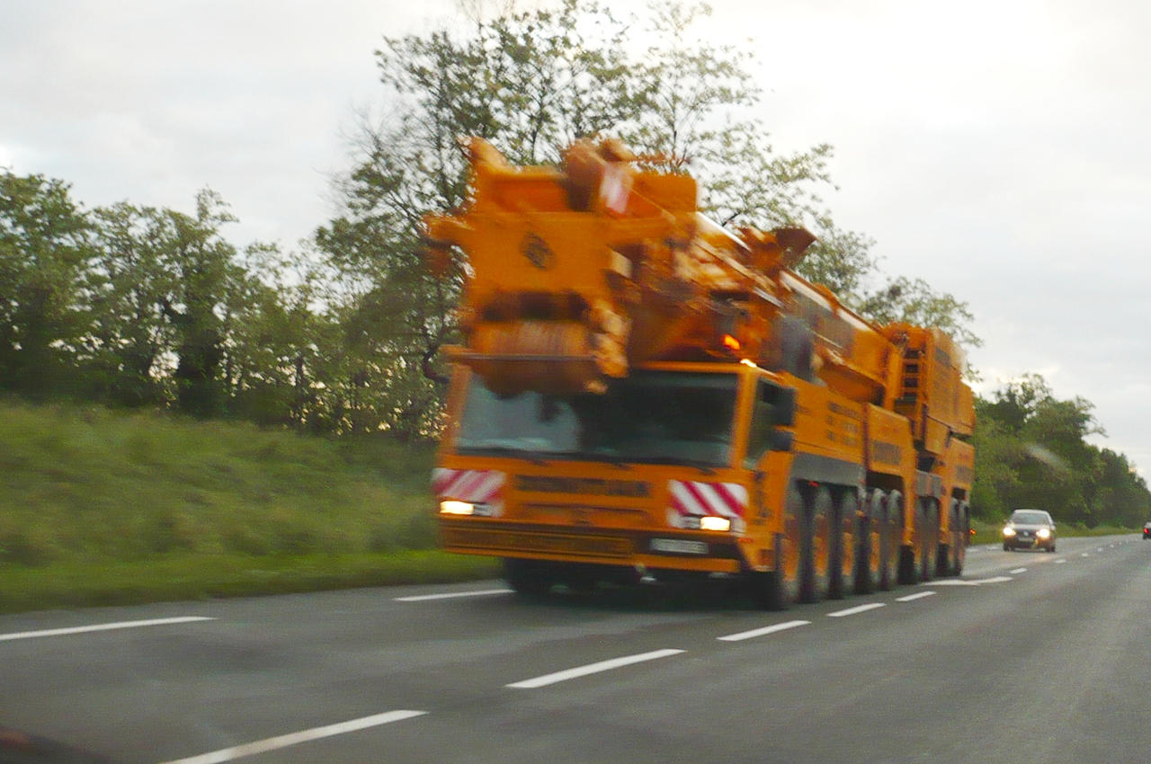 Big red Crane on the road by nicolapin