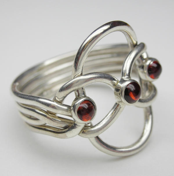 puzzle ring with 3 garnets by vansee jewelry on deviantart