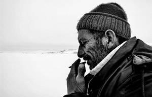 Fisherman Smoking by cahilus