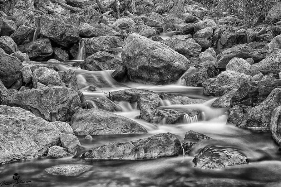 Water and Boulders BW by mjohanson