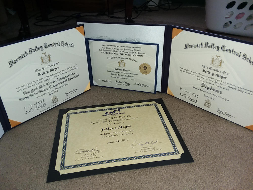 and heres my diplomas X3 by JSMRACECAR03