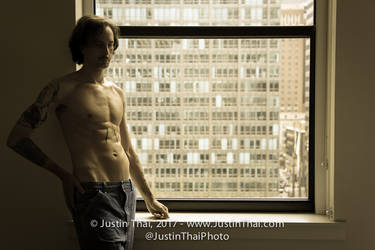 shirtless in window