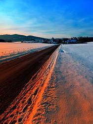 Winter road at sundown by patrickjobst
