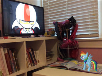 Rainbow Dash is watching her favorite show