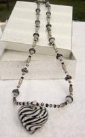 Glass Zebra Heart Necklace by kjtgp1