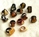 Wooden rings with baltic amber
