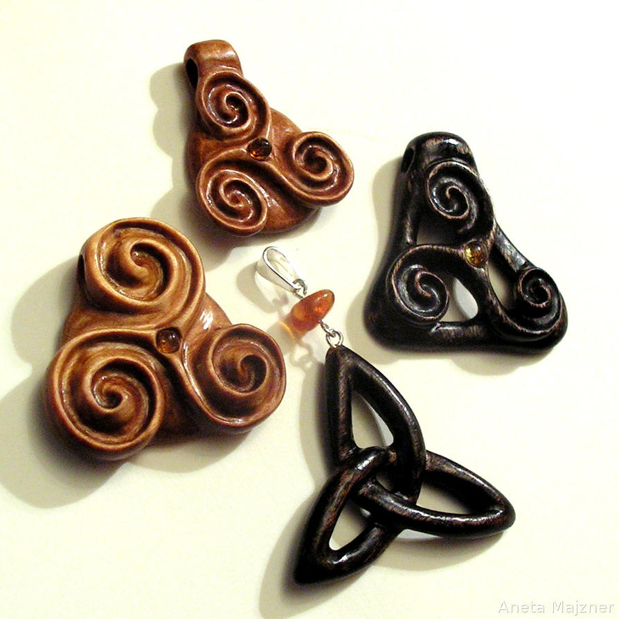 Triskalion Hand Carved Wooden Pendants By Ambersculpture