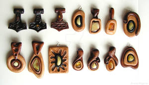 Wooden pendants with baltic amber