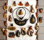 Hand carved wooden pendants with amber