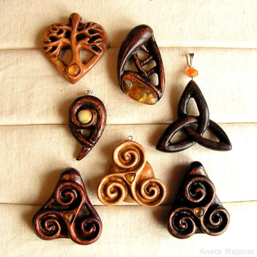 Triskelion triquetra wooden pendants with amber by ambersculpture on triskelion triquetra wooden pendants with amber by ambersculpture aloadofball Gallery