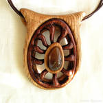 Hand carved wooden pendant with baltic amber 1670