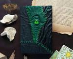 Green leather patchwork necronomicon