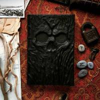 black skull grimoire by MilleCuirs