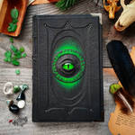 Dark book with green glow