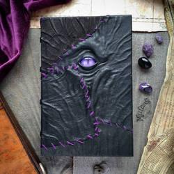 Purple stitched necronomicon by MilleCuirs