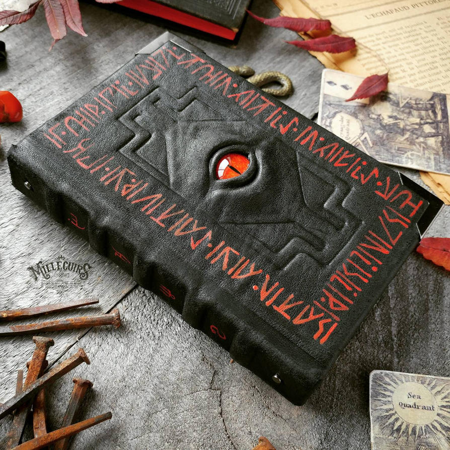 Black necronomicon with red runes by MilleCuirs