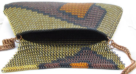 Maille purse with lid laid out.