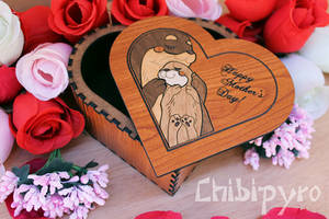 Otter mom with cub heart shaped box