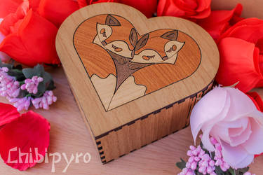 Heart shaped box with foxes marquetry