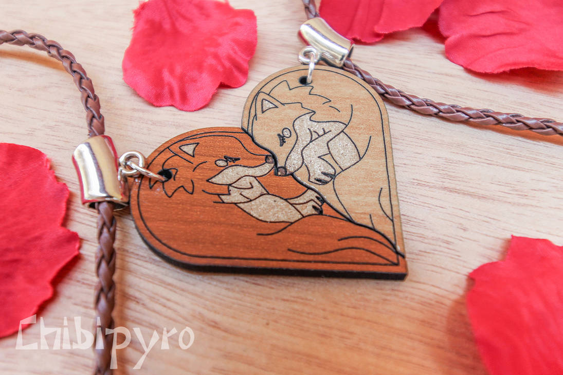 Wolf heart shaped wooden charms by ChibiPyro