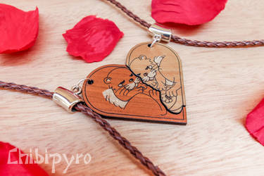 Otters heart couple necklaces by ChibiPyro