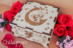 Cat on feather wooden box by ChibiPyro