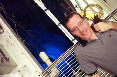 Professor Gomez above an operating Triga reactor