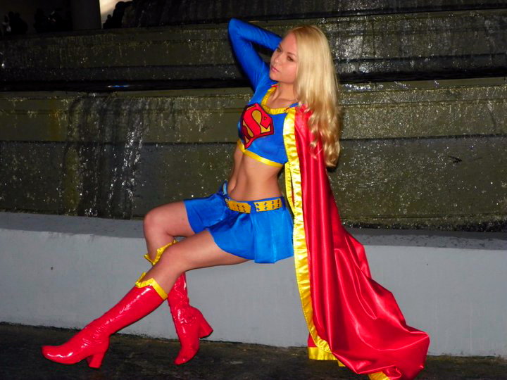 Supergirl sitting by AlisaKiss