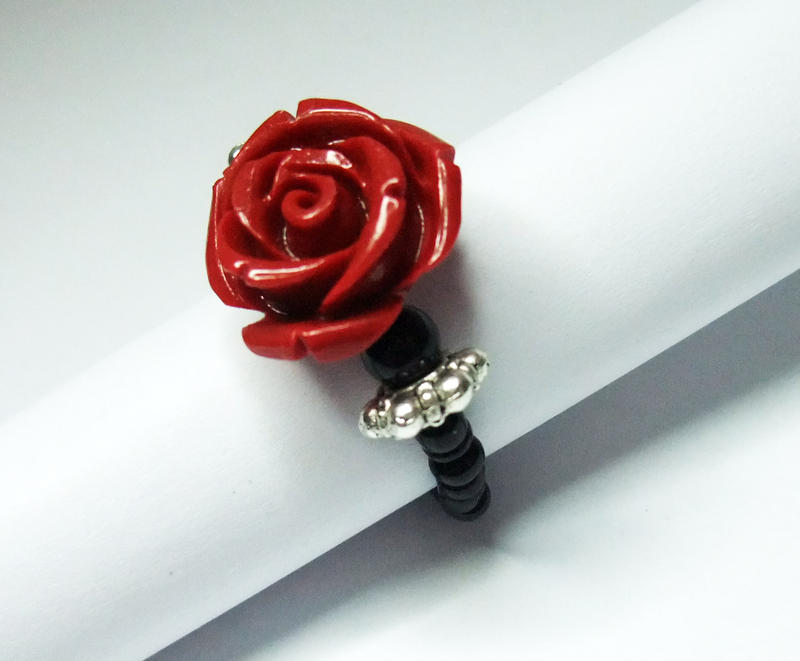 rings with red resting rose on picture table wedding online a stock two